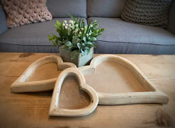 A Set Of Three Wooden Heart Trays